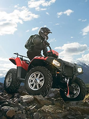 ATV rider on rocks