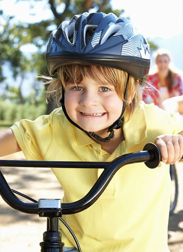 Little boy on his bike on a fun ride