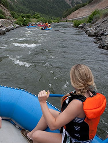 Woman rafting down the Provo river