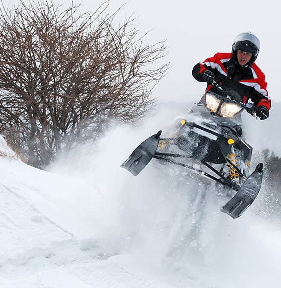Snowmobiling over jump