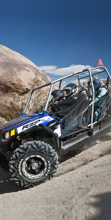 Large-UTV-with-riders-on-a-dirt-road-new